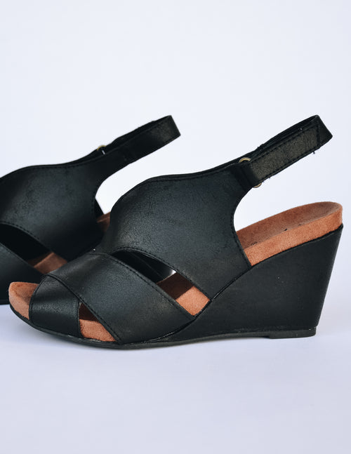 Black distressed faux suede upper with velcro back trap and fabric covered wedge
