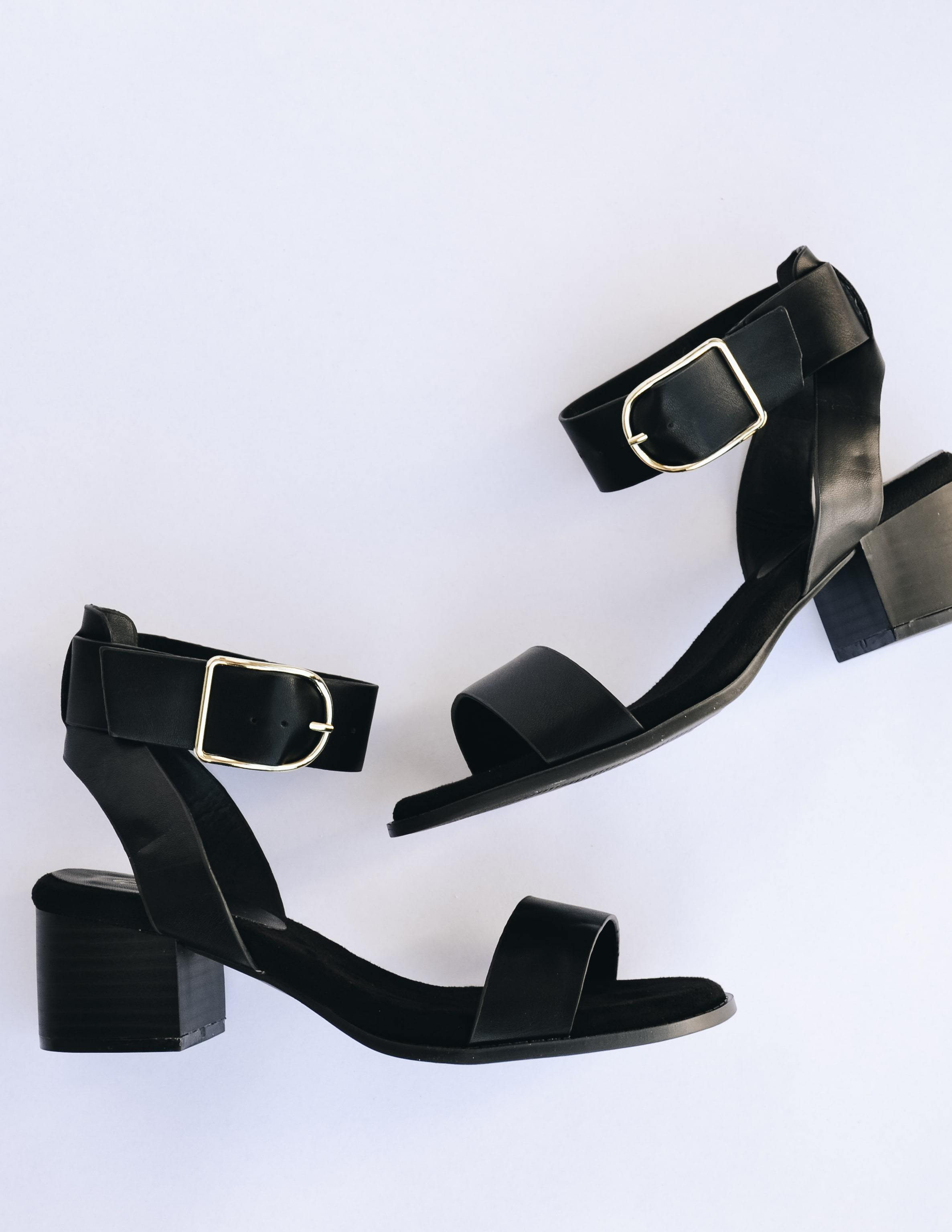 Black rich girl heel with black block heel and straps over toe and ankle
