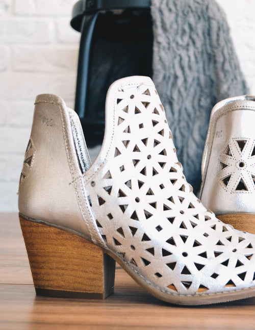Silver athena bootie with laser cut front and cut out floral detail on back