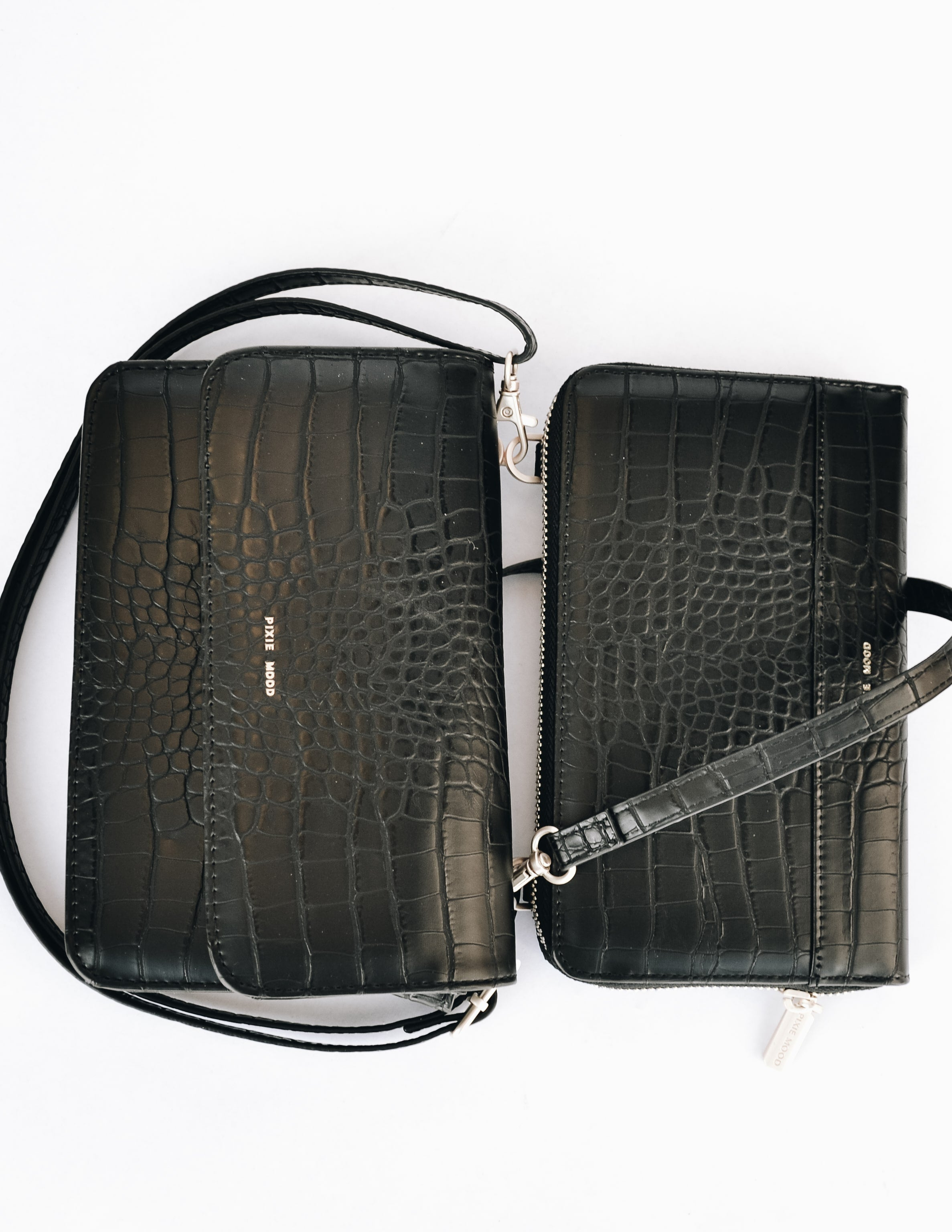 Jane 2-in-1 wallet connected by adjustable strap with magnets separated