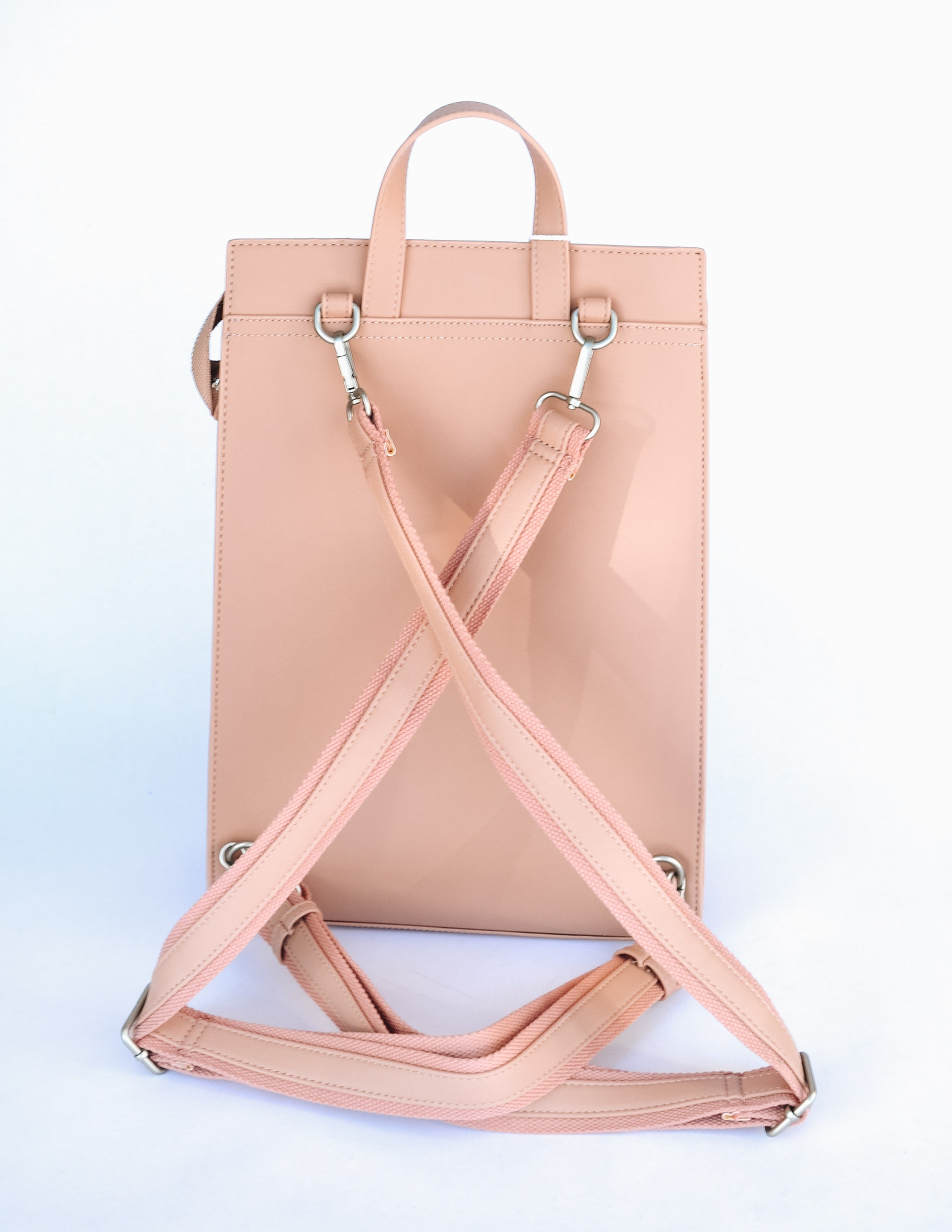 Apricot carrie backpack showing the back interchangeable straps