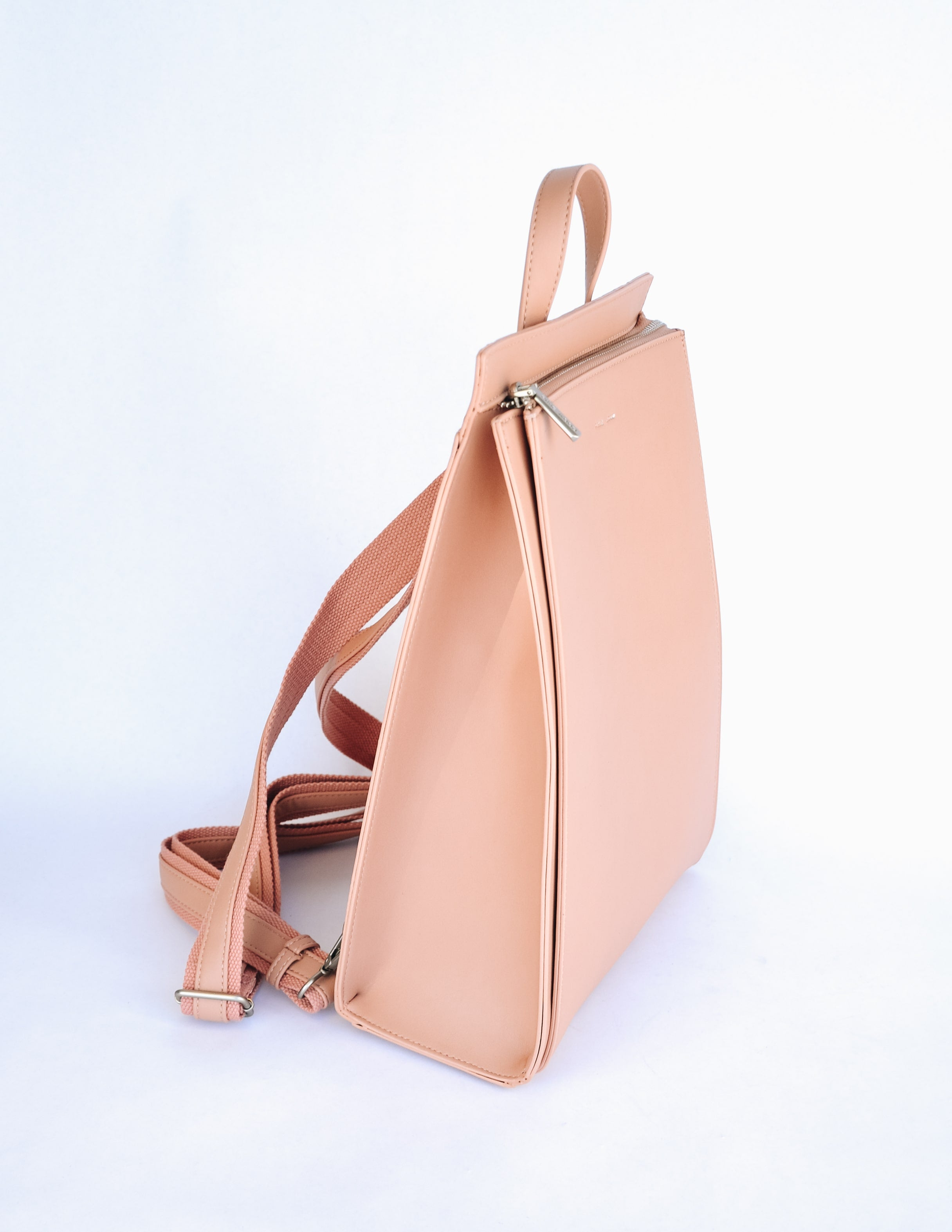Pixie mood carrie backpack in apricot on white background - elle bleu