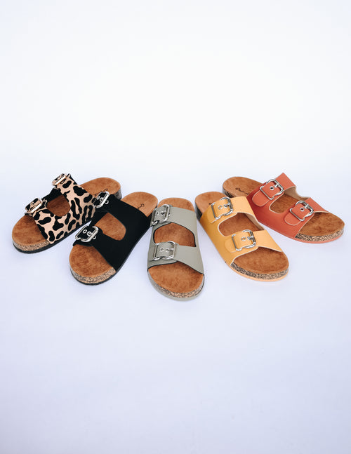 Several colors of the high tides sandal lined up on white background