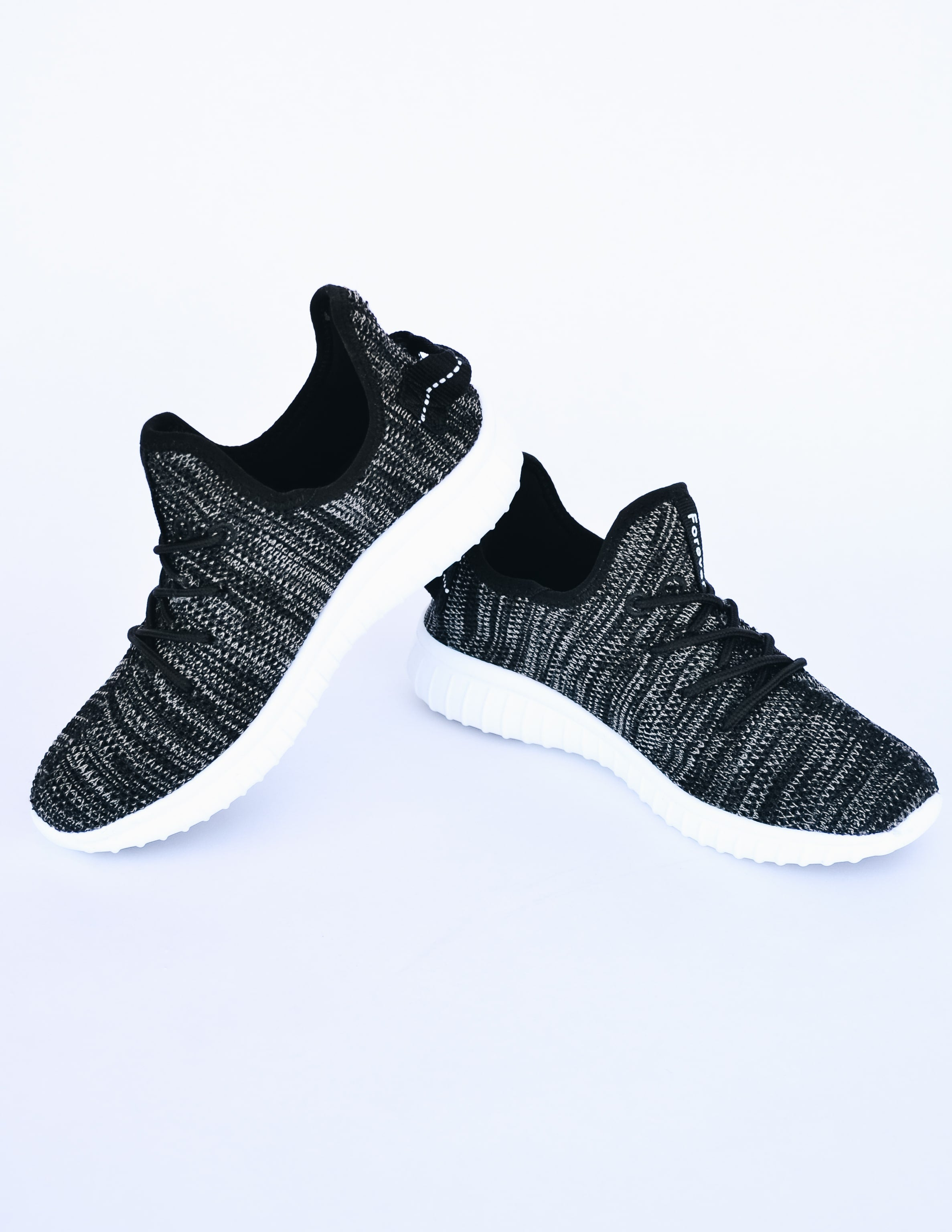 Black heathered run along now sneaker with white sole and black laces