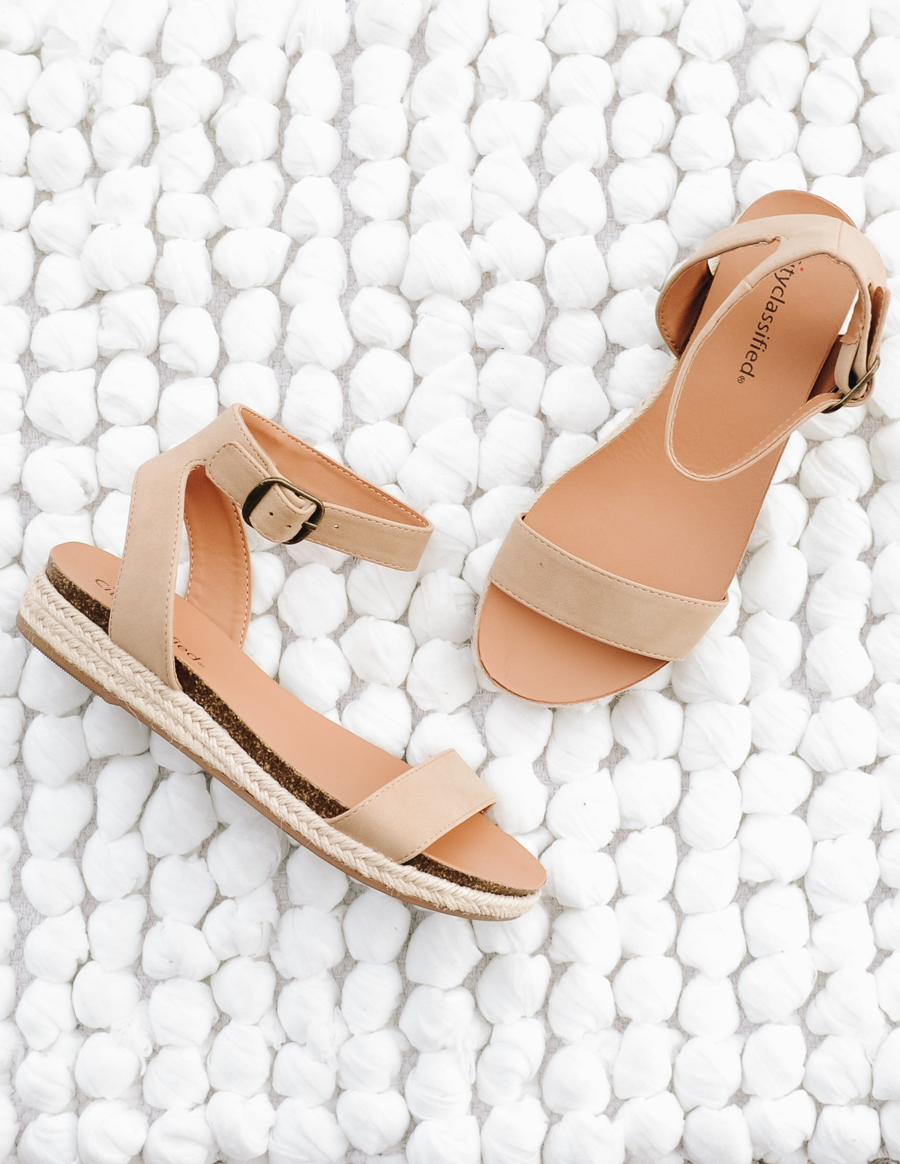 Taupe urban vacay sandal laying flat on white bubble rug - elle bleu shoes