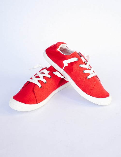 Red sneaker on white background - elle bleu