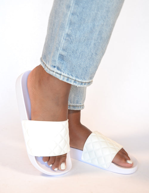 White quilted slide sandal on model - elle bleu shoes