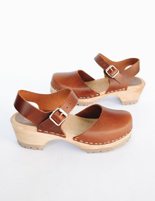 Luggage brown freja clog with closed toe and ankle strap on wood sole
