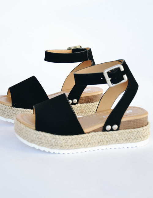 Black kid girl platform sandal with rope trim around sole and adjustable buckle strap