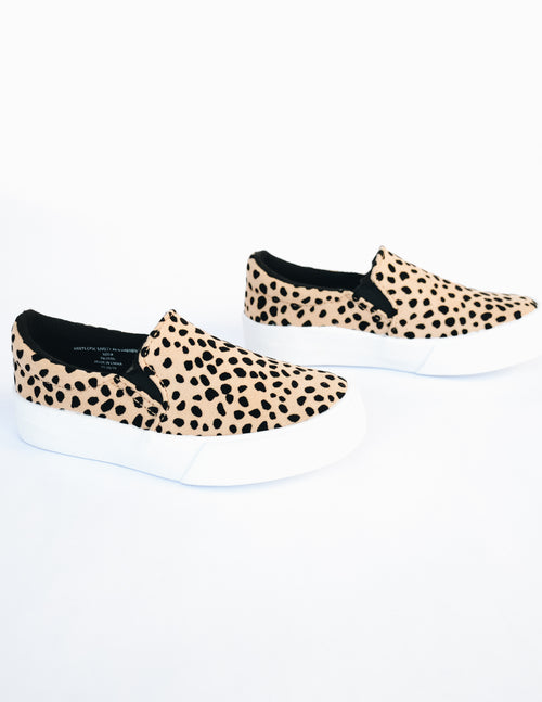 Cheetah print kid girl sneaker with white rubber sole and black elastic insert