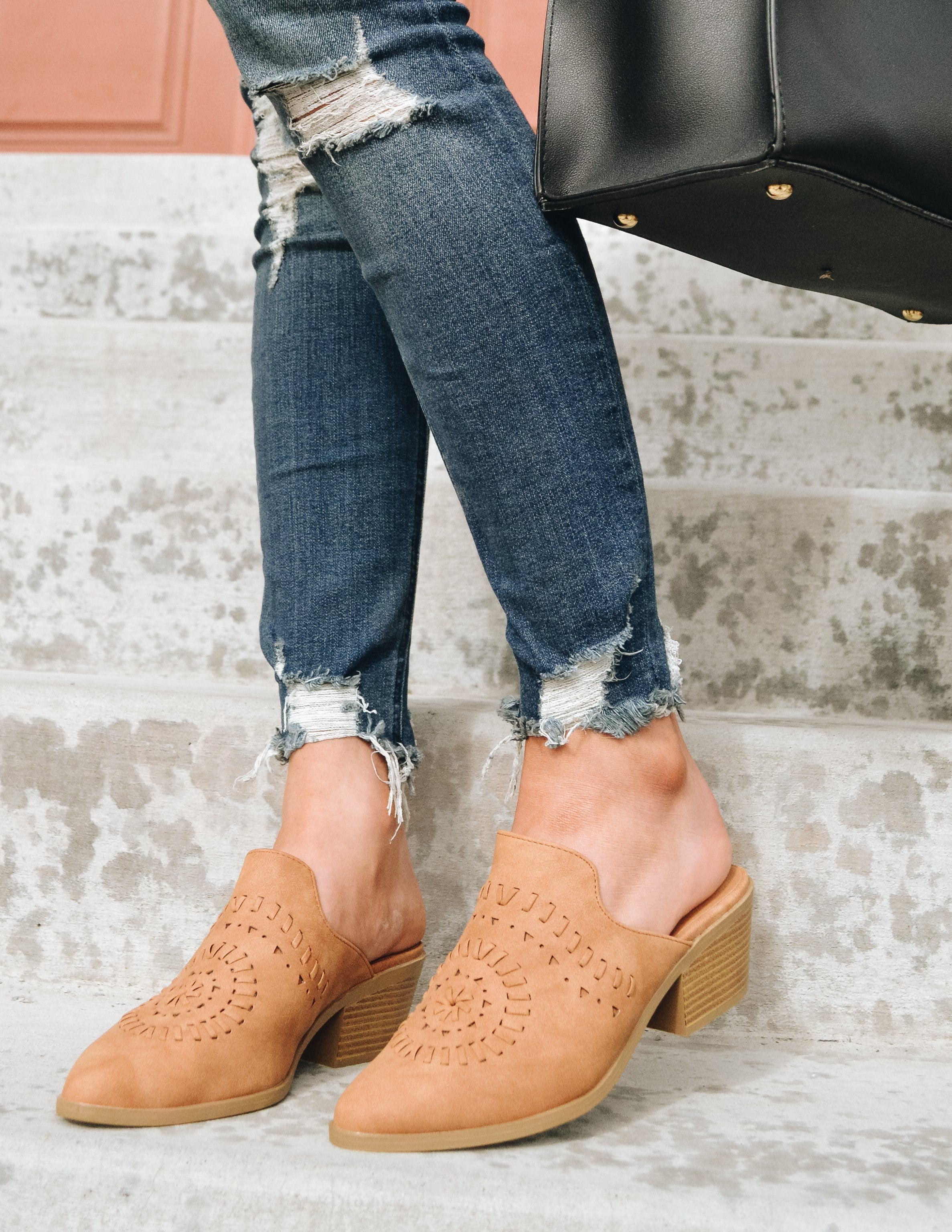 model standing on concrete steps in denim and camel mule - Elle Bleu Shoe Boutique