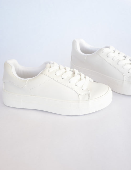 White thick platform sneaker on white background