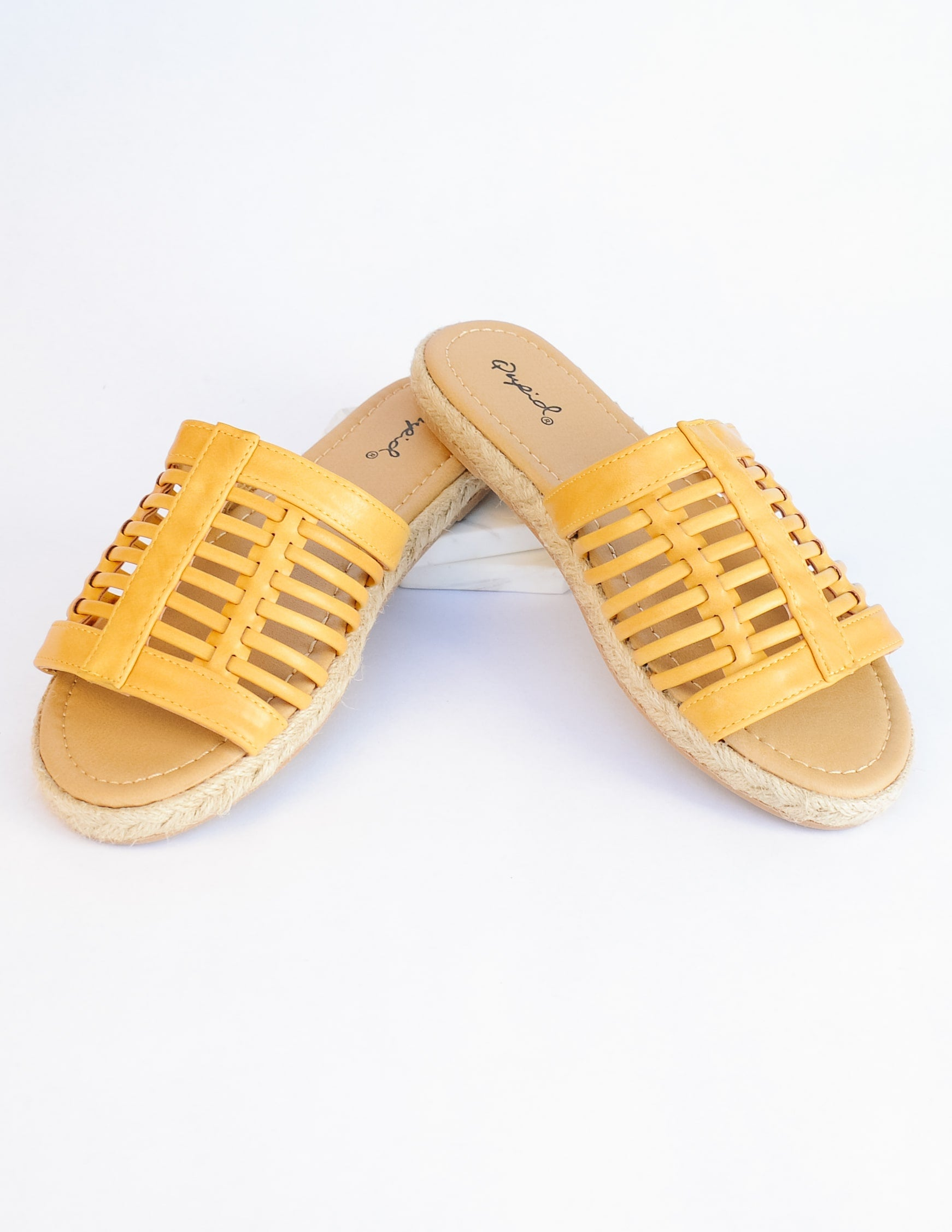 Mustard surf's up sandal with cage upper and tan insole on white background