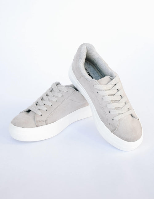 Smoke grey sneaker with flat wide laces and thick white sole