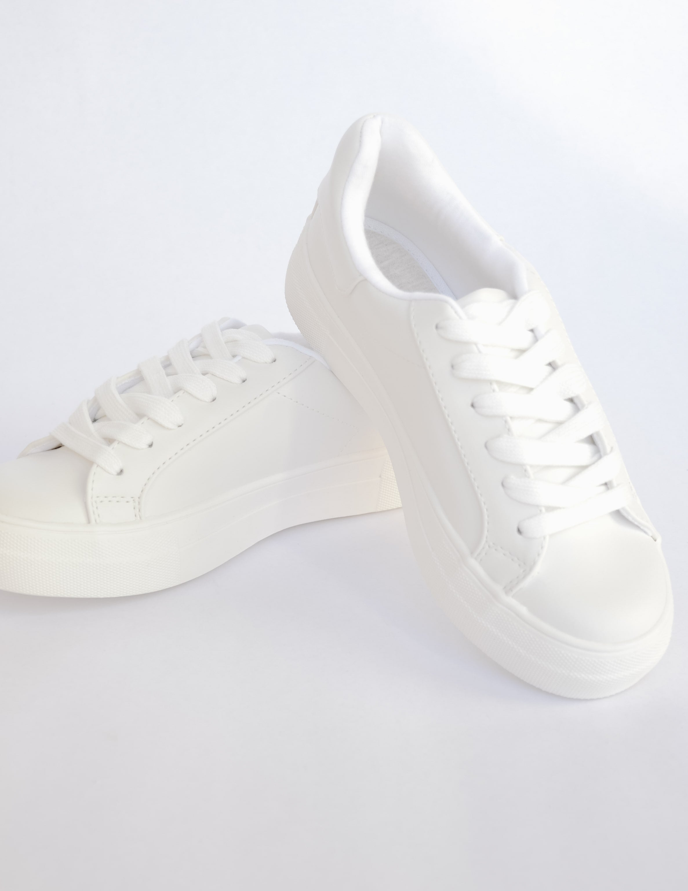 All white sneakers with flat wide laces and thick rubber sole - elle bleu shoes
