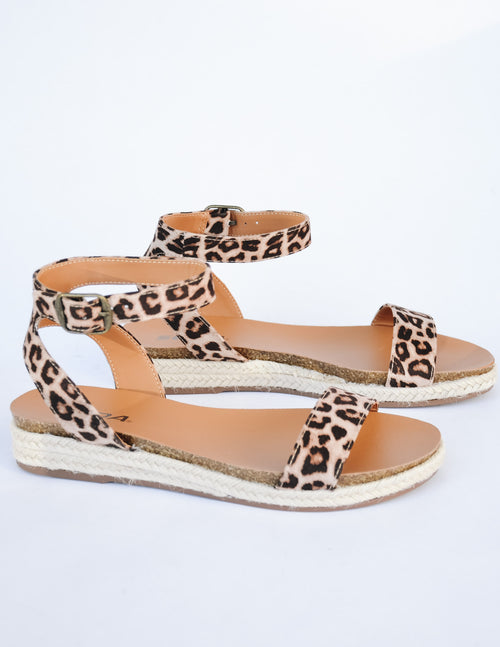 Cheetah print sandals with rope trim around sole on white background