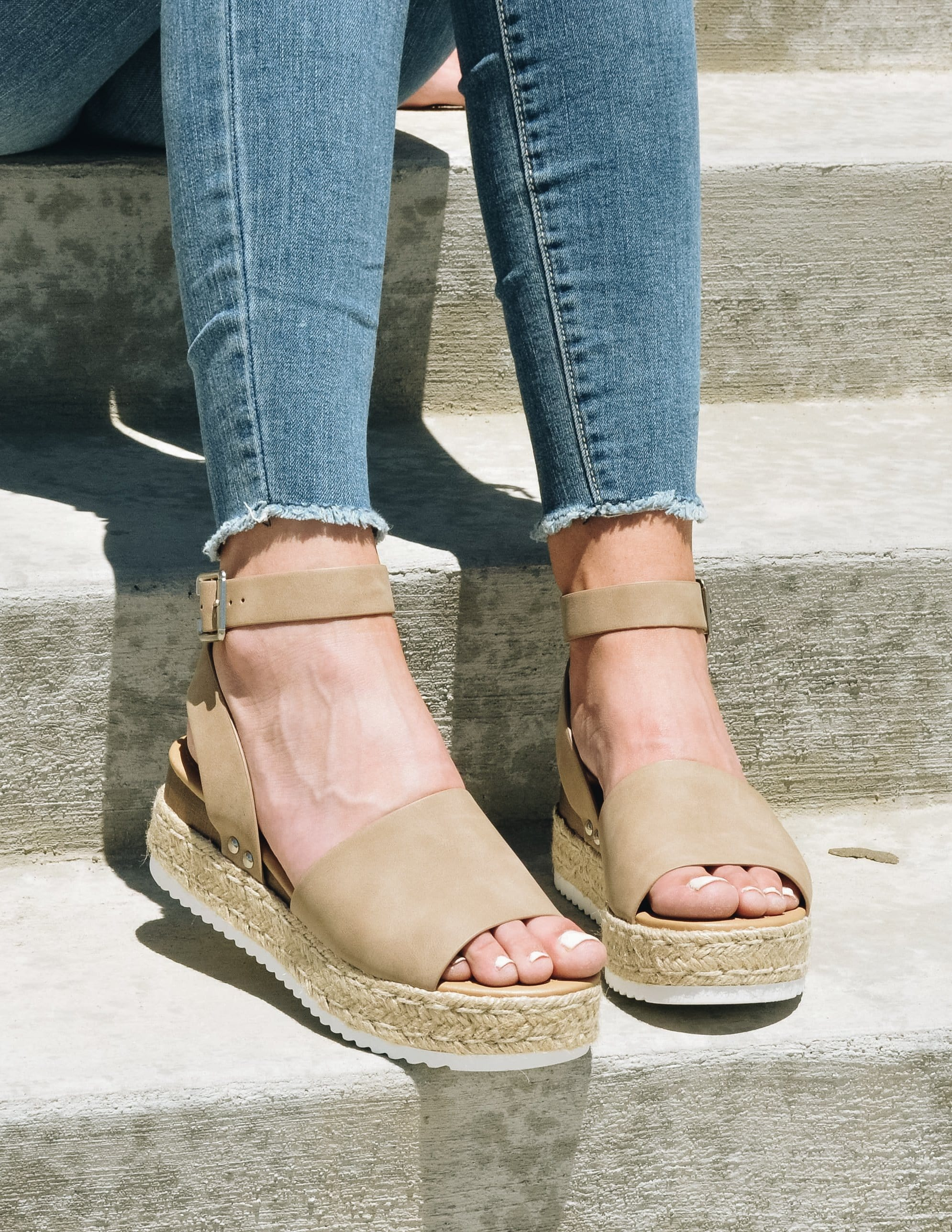Taupe platform sandals with rope trim on model's feet - elle bleu shoes