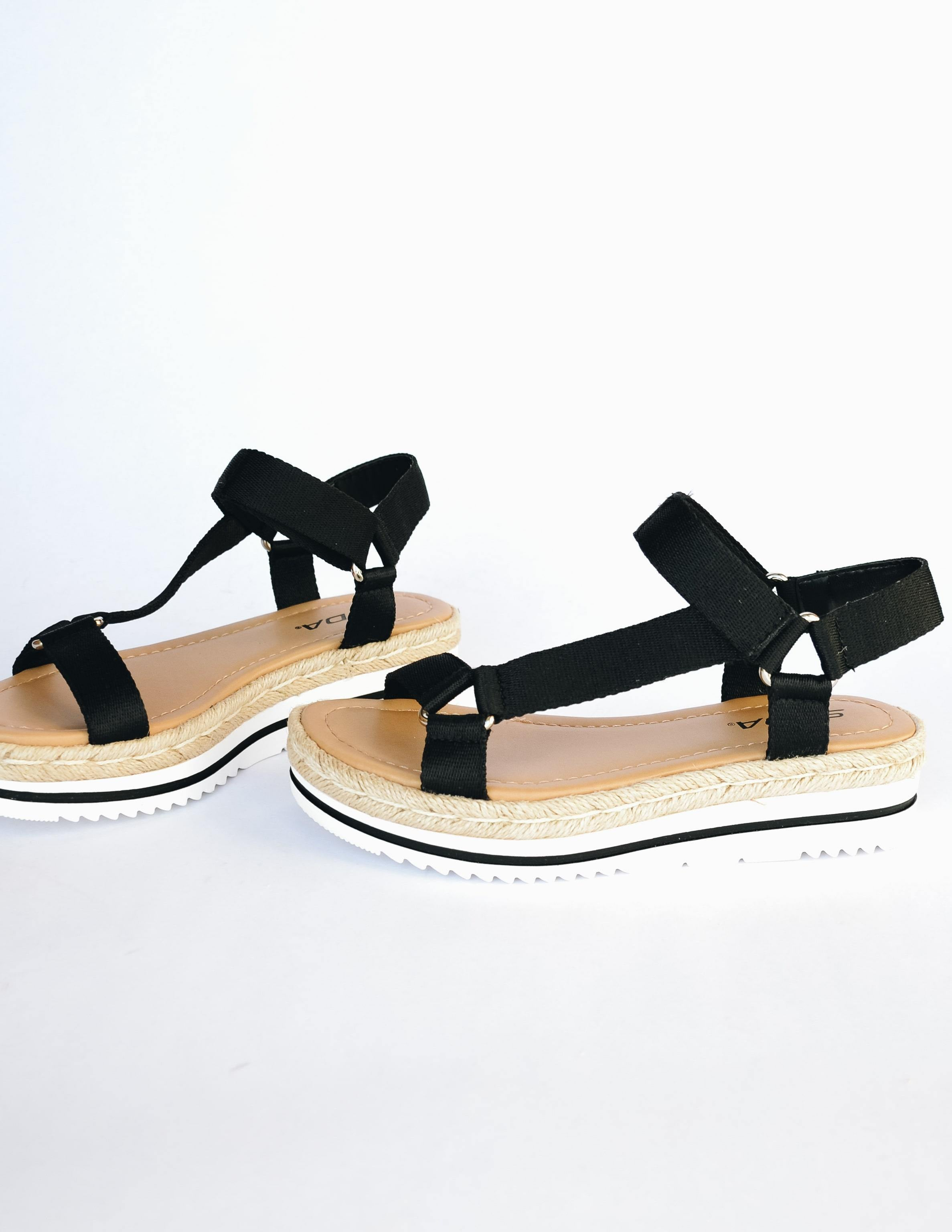 Black nylon strap sandals with rope trimmed white bottom platform sole