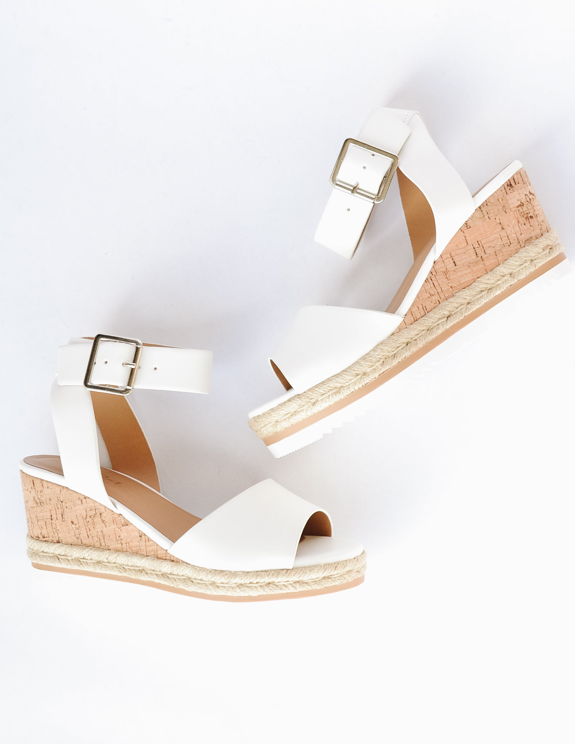 White open toe wedge with faux cork sole and rope trim around bottom