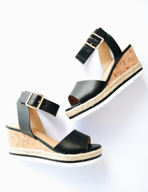 Black wedge with faux cork sole and rope trim around bottom