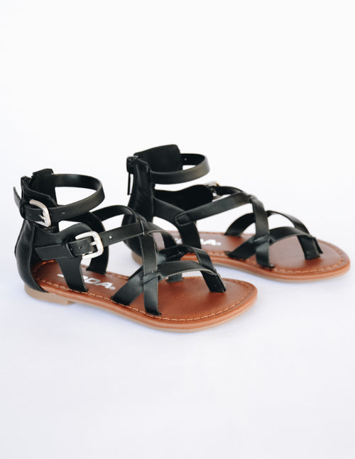 Black kid girl sandal with black upper and tan sole on white background