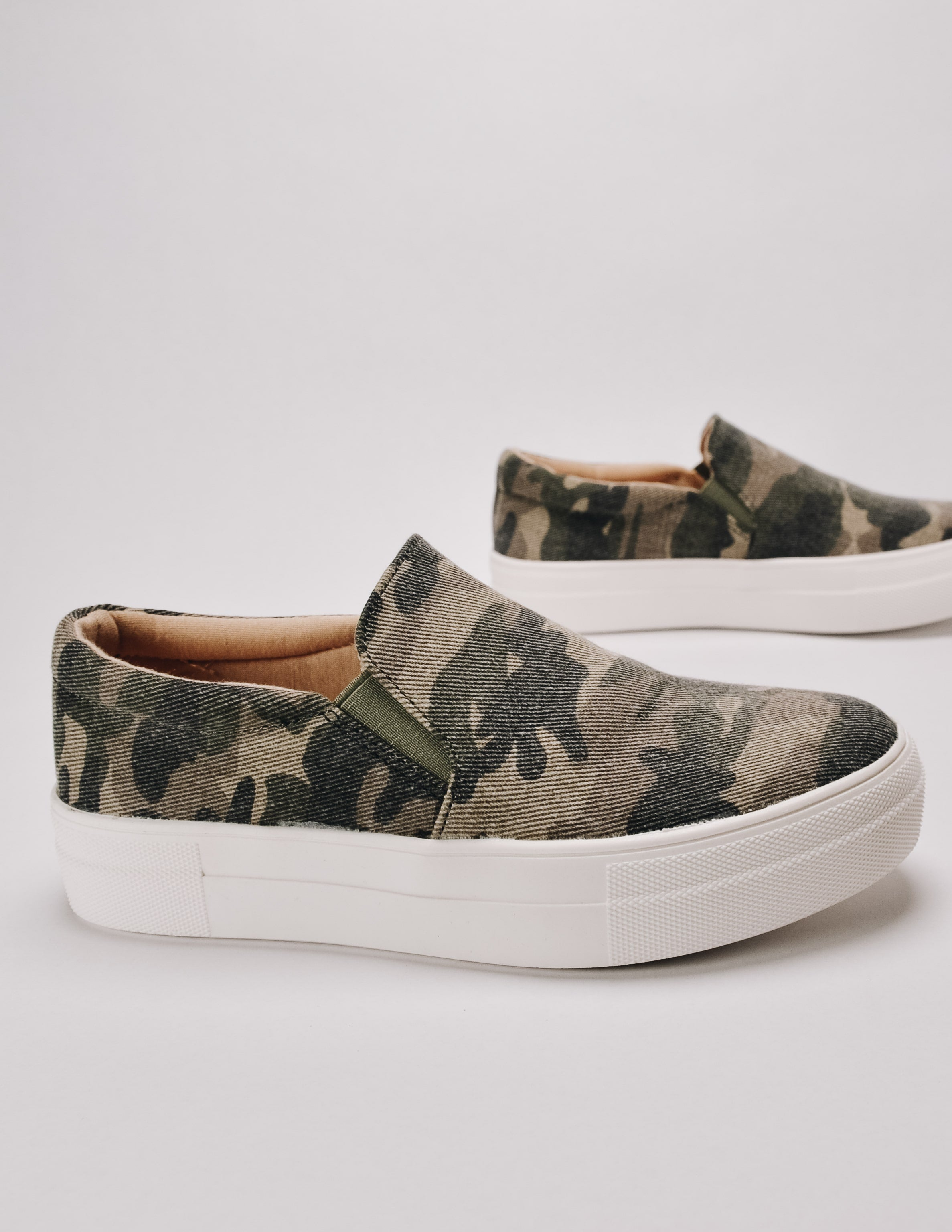 Camo slip on sneaker with white thick platform sole