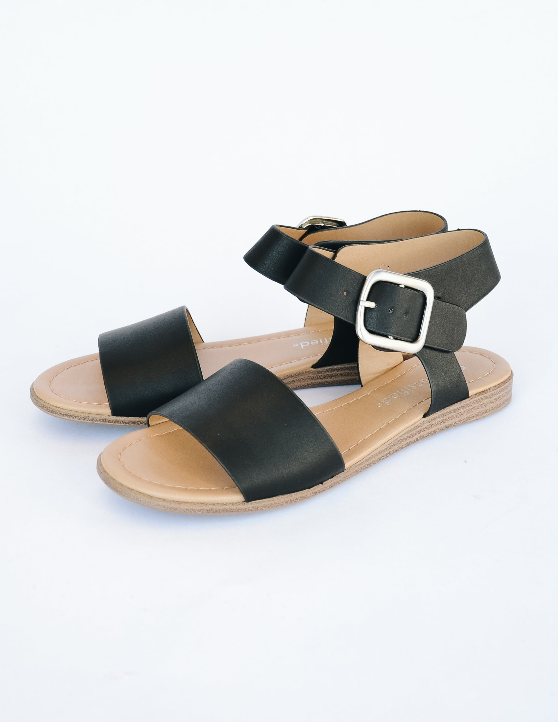 Black sandal with tan insole on white background - elle bleu shoes