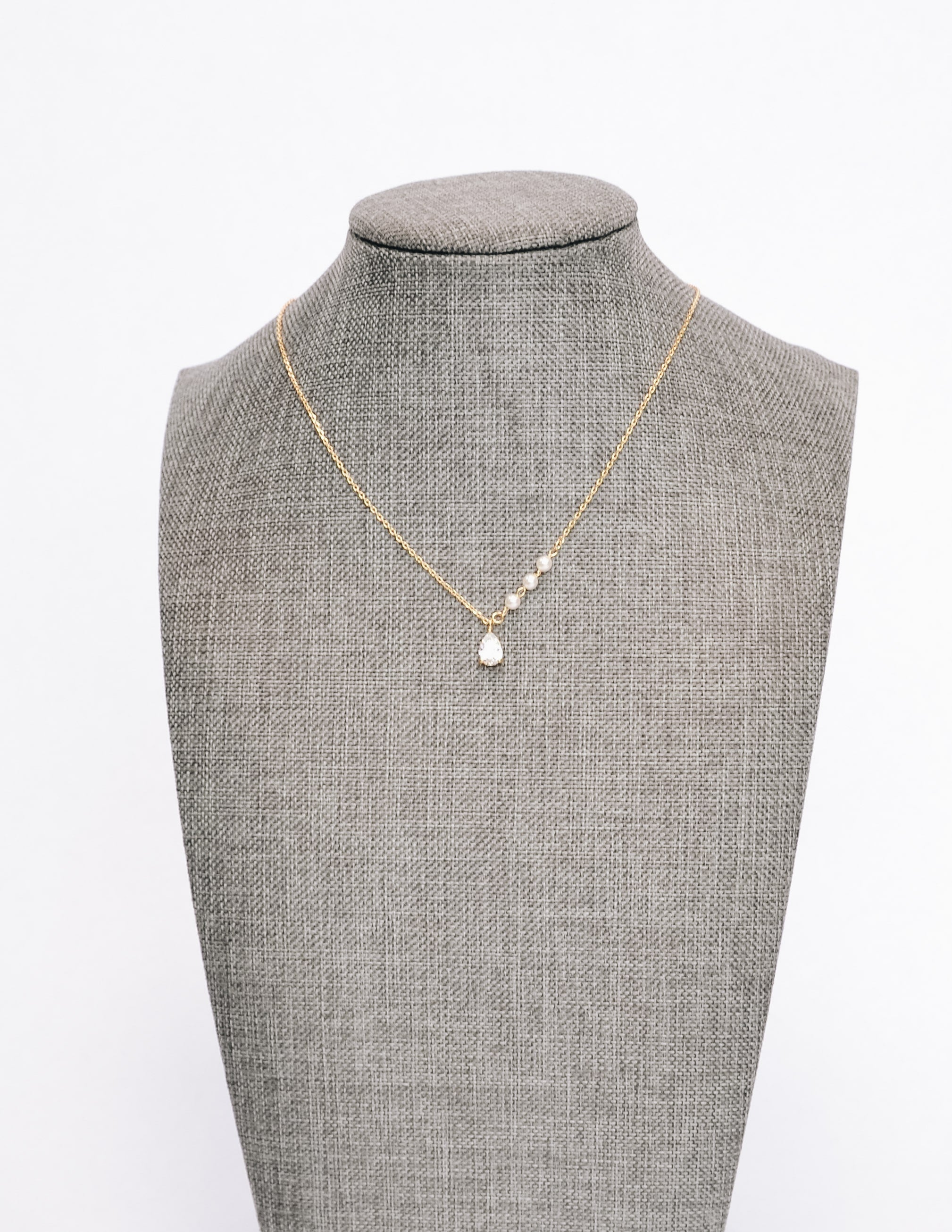 Gold statement grey caprie necklace on form - elle bleu
