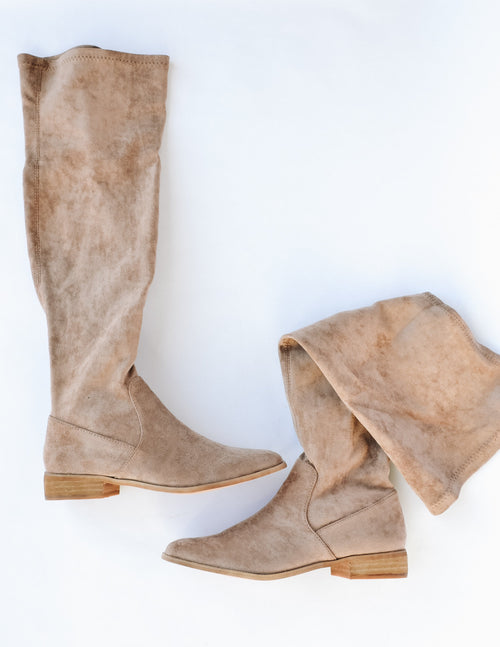 Taupe gwen over the knee boot with shallow wood heel on white background