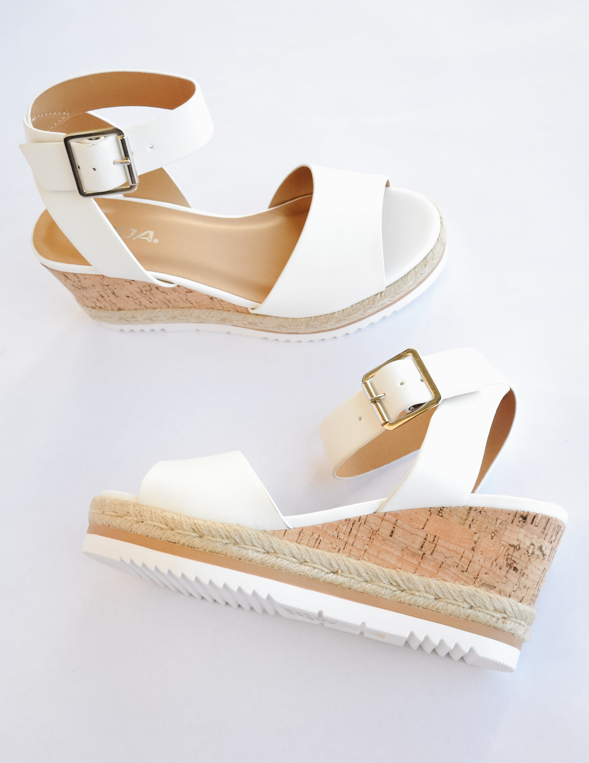 White upper and bottom, cork wedge heel with rope trim around bottom