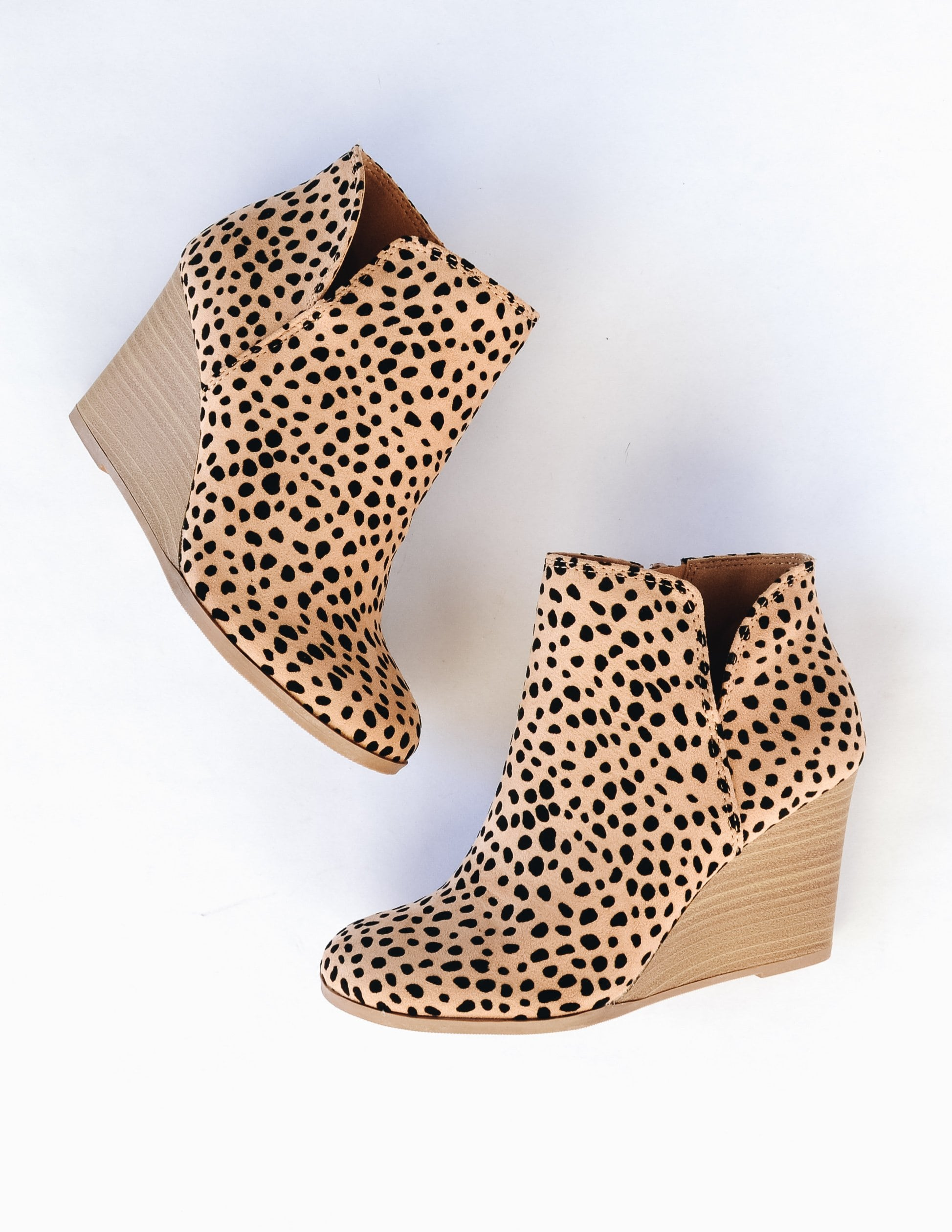 Cheetah print risk taker wedge heels laying flat on white background