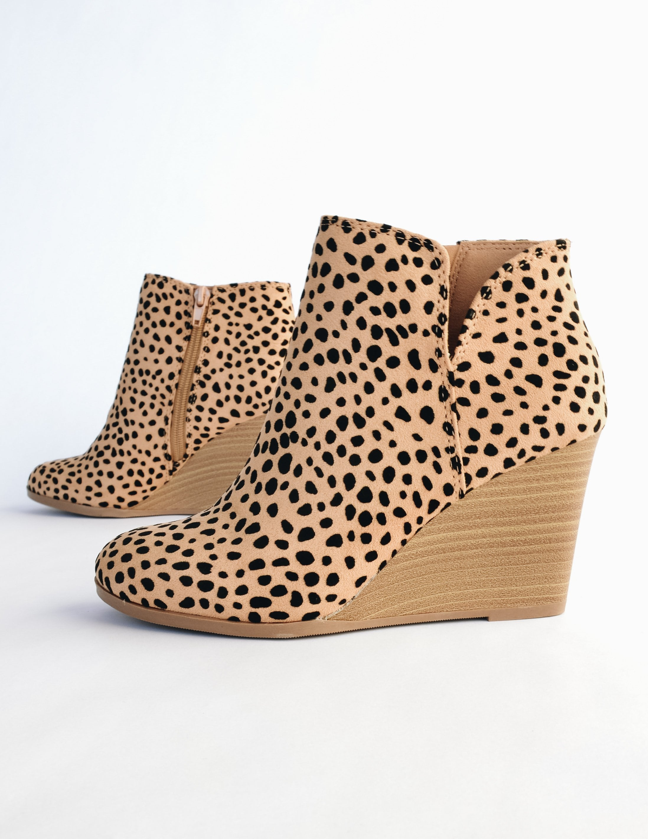 Cheetah print wedge with faux stacked wedge heel and small v cut on side