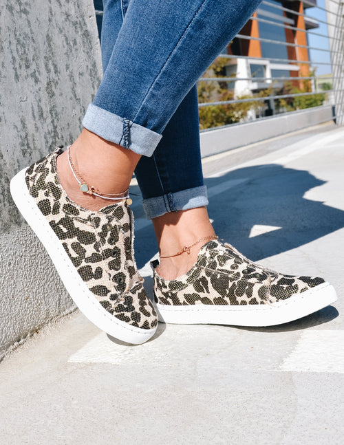 Closeup of model standing in get your sneak on leopard sneaker