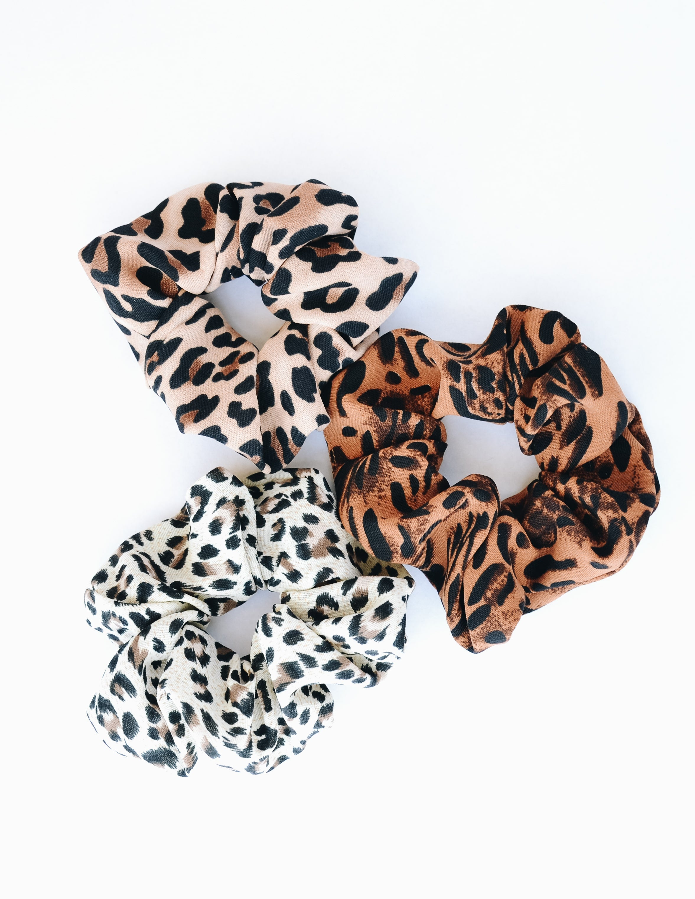 Cheetah print hair scrunchies on white background - elle bleu