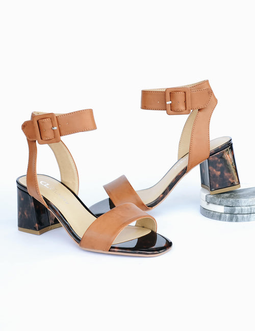 Tortoiseshell print heel and sole with tan toe bridge strap and ankle strap
