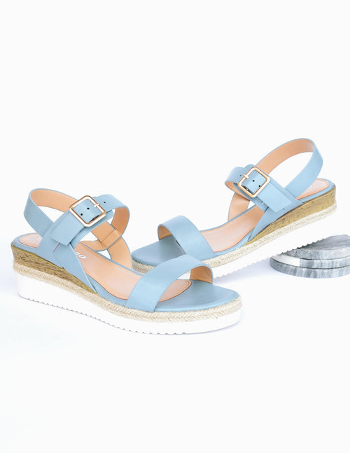 Blue wedge sandal with white platform sole and faux wood detail