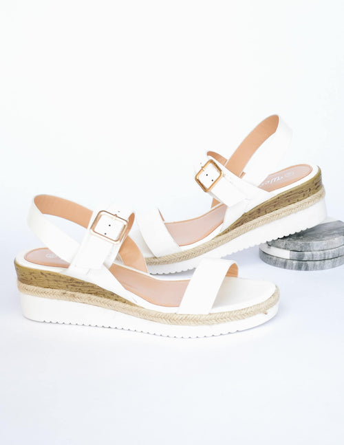 White straps on white platform wedge sole with faux wood detail