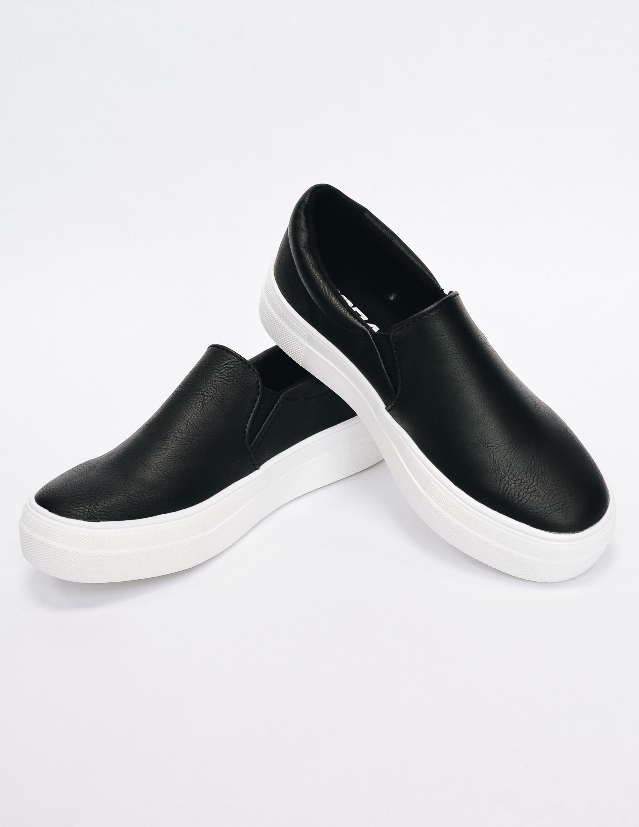 Black slip on sneaker with white rubber sole