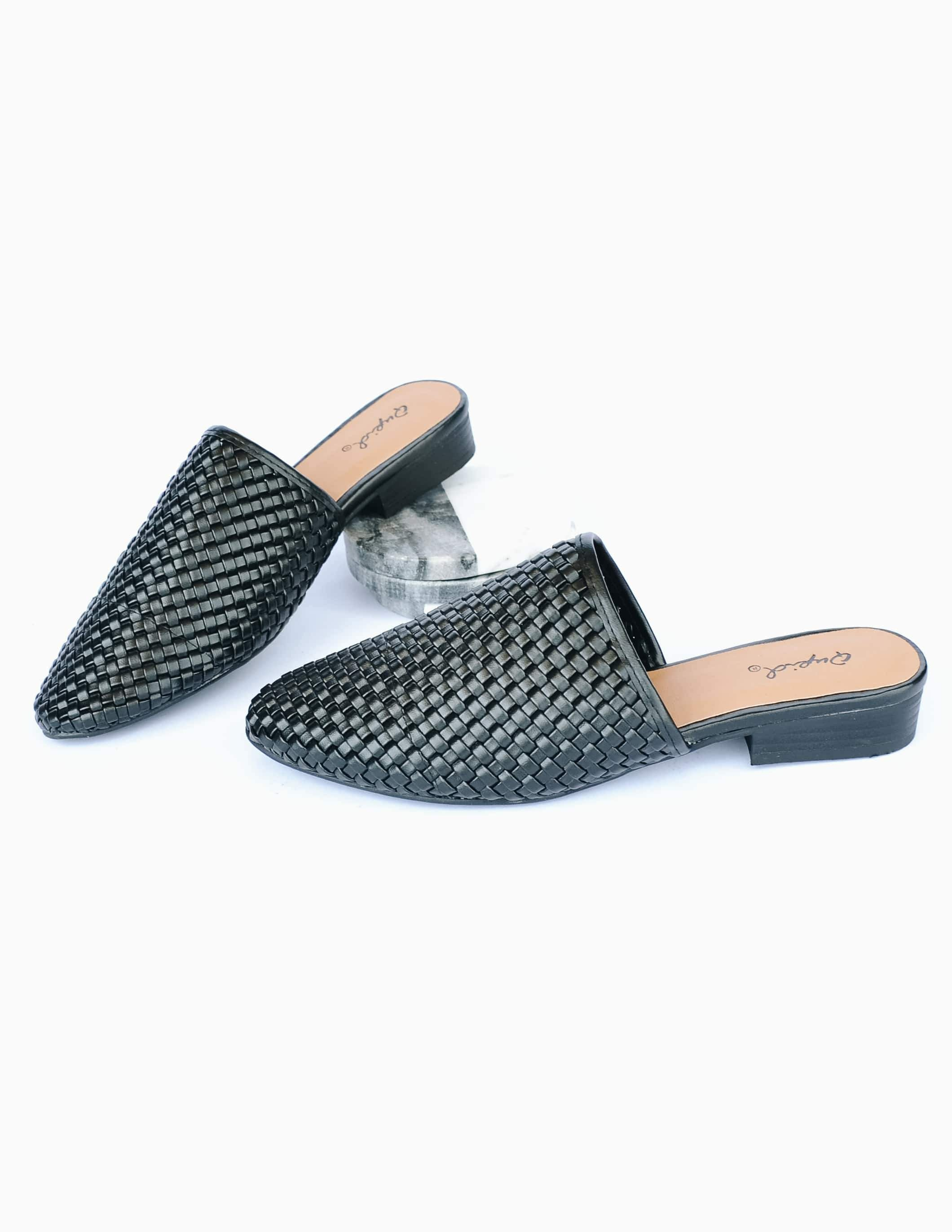 Black woven upper on black sole with tan padded insole on white background