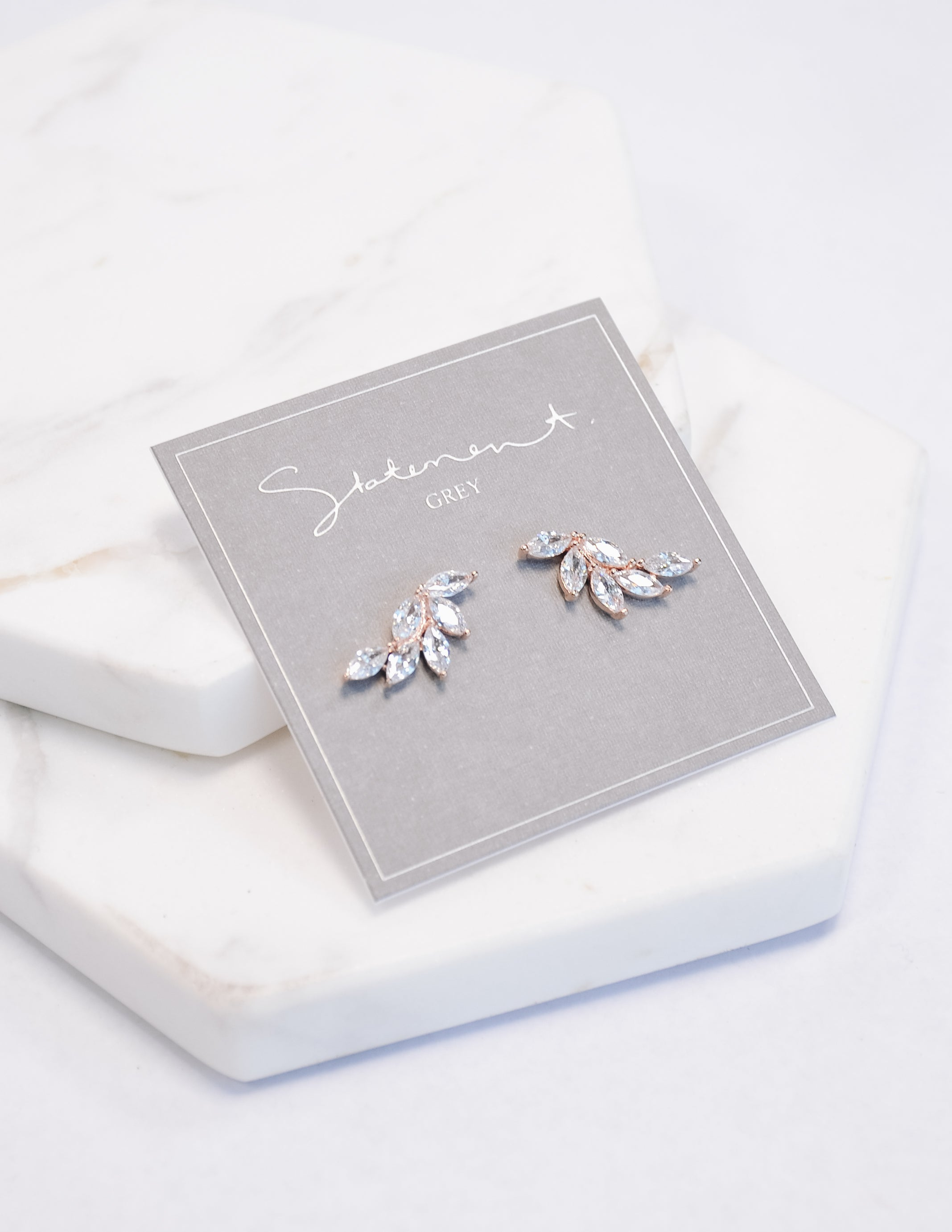Angel wing marquise earrings on grey card - elle bleu