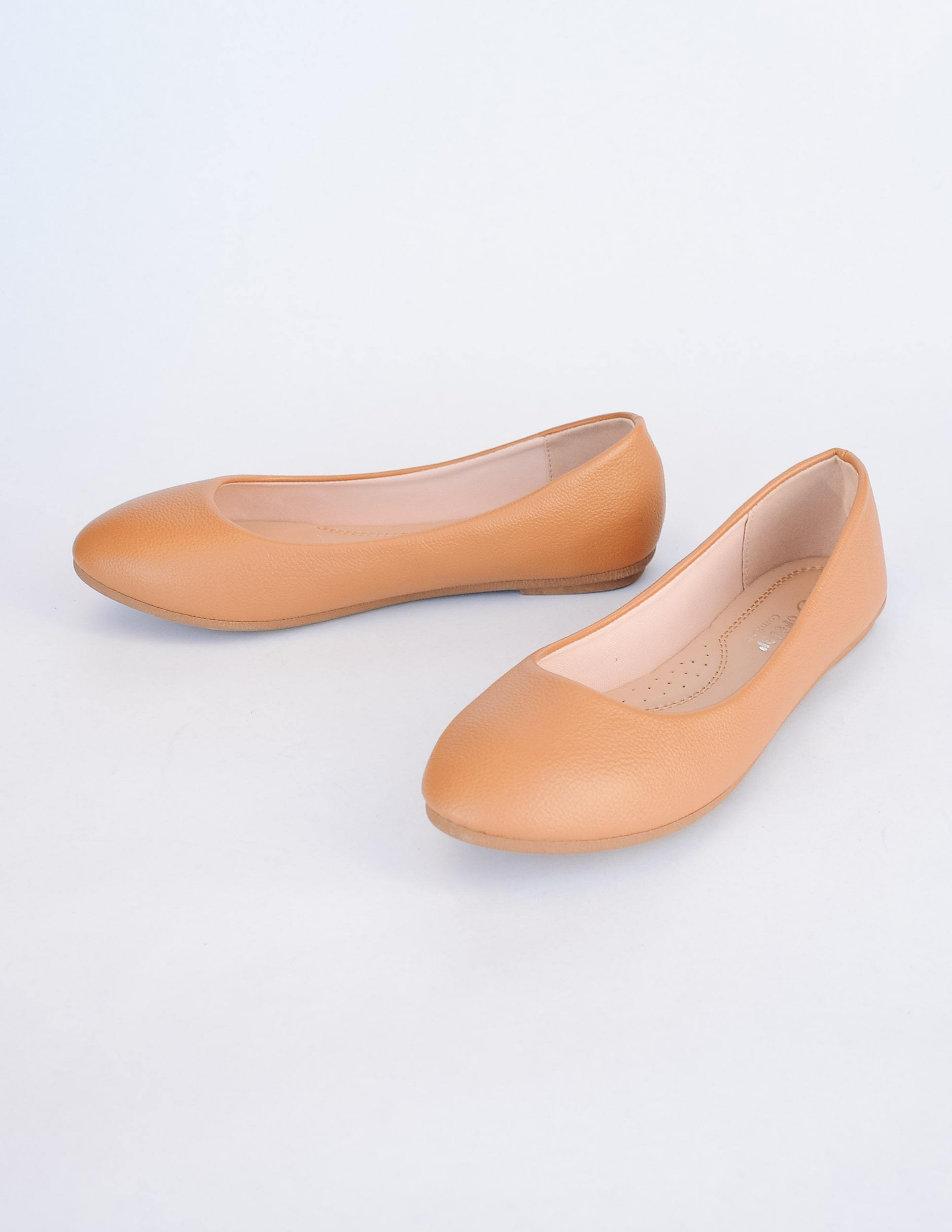Tan round toe vegan pebble leather flat with light tan insole