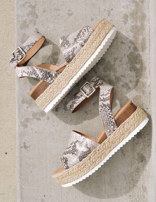 Grey snake print platforms with rope trim and white bottom tread