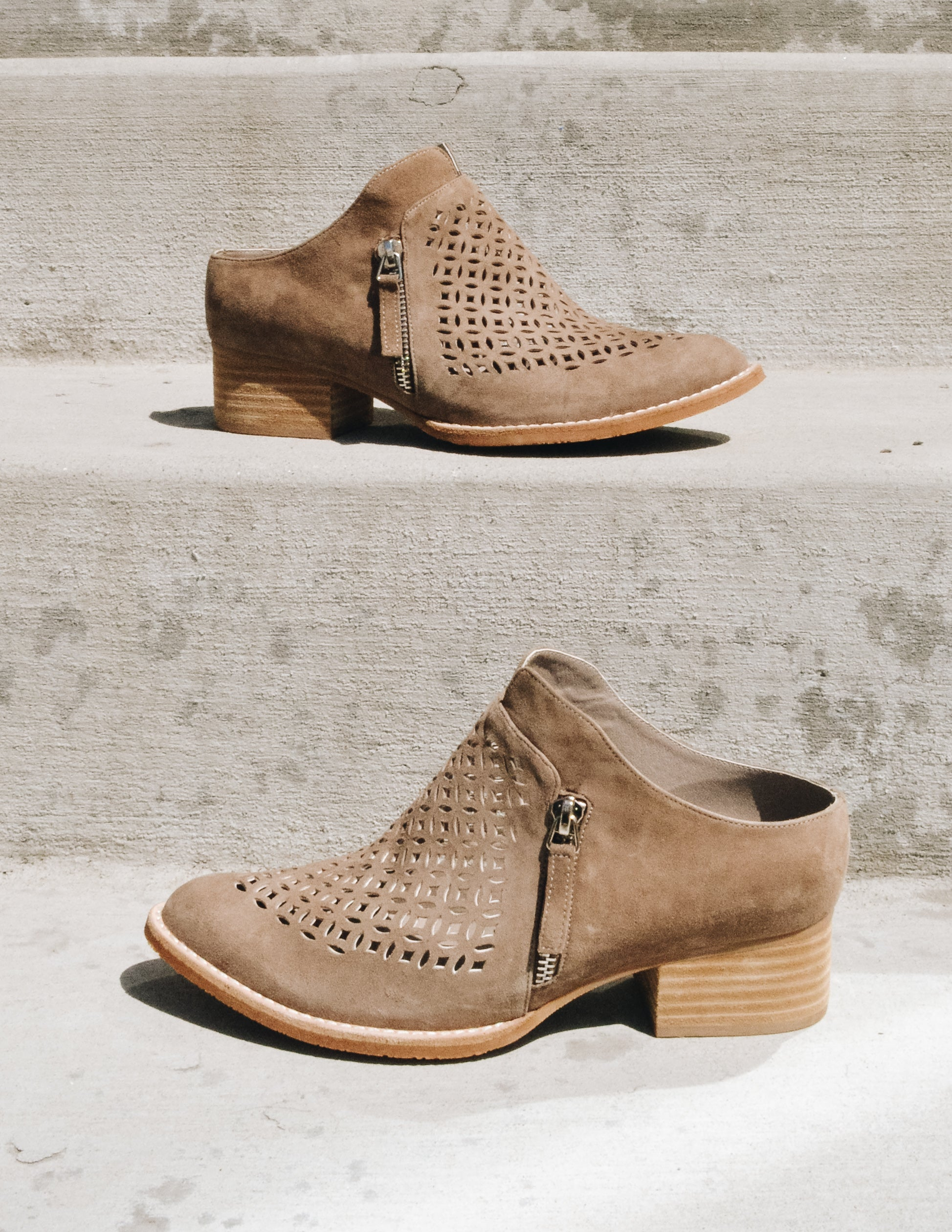 Taupe Taniss Sbicca bootie on concrete steps, one on top of the other - Elle Bleu Shoe Boutique