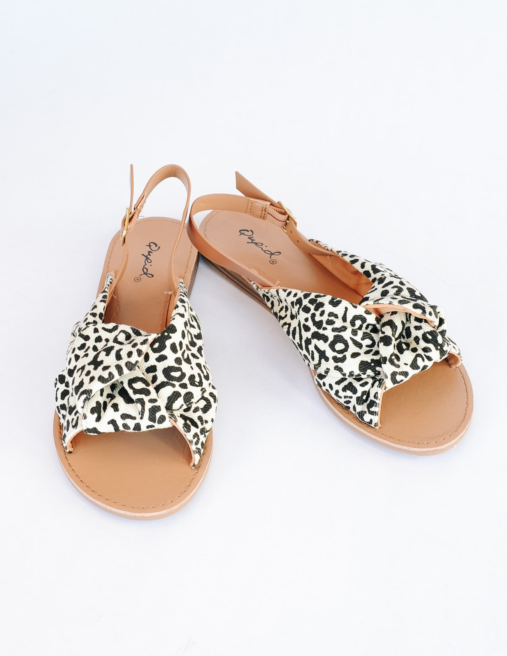 Leopard run wild sandals with tan insole on white background - elle bleu