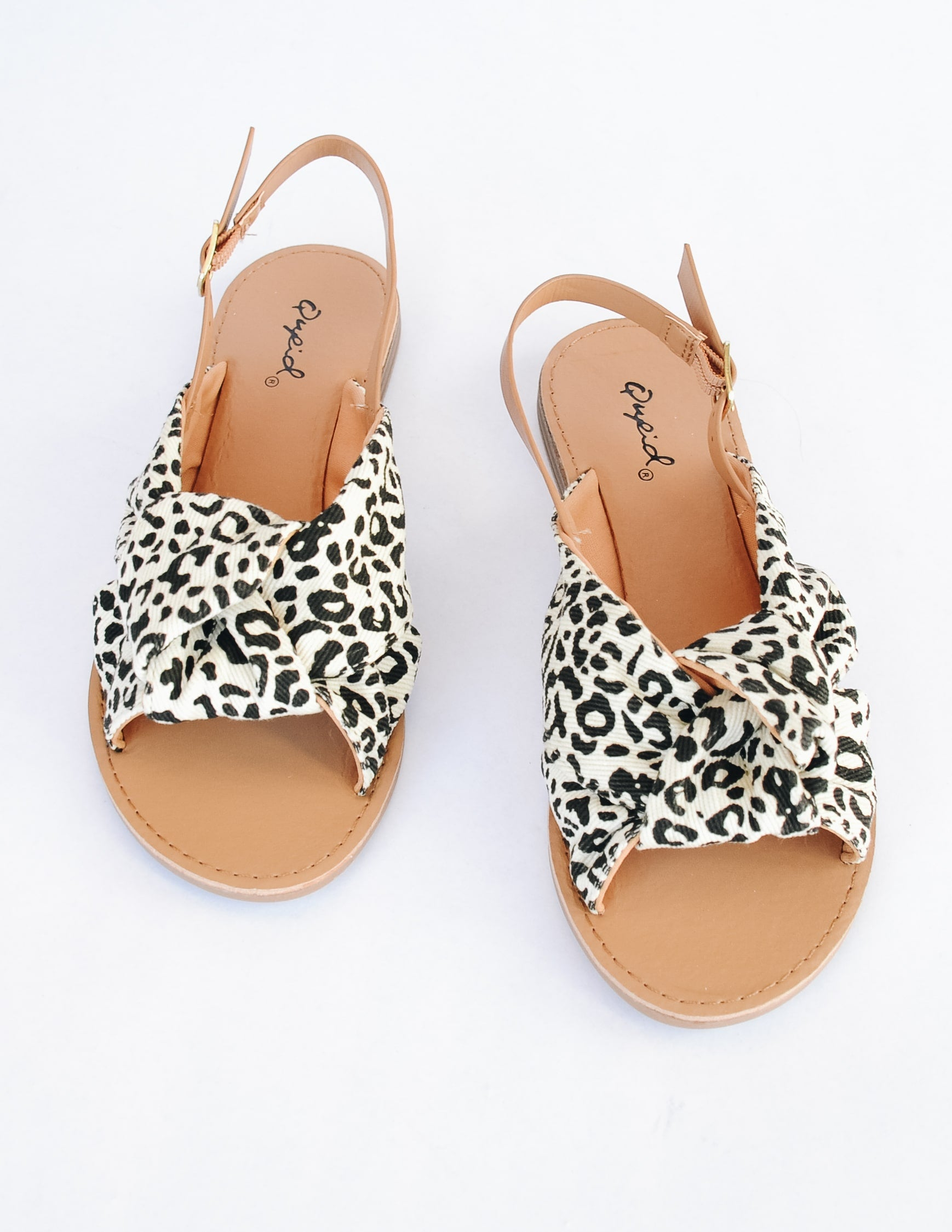Leopard print run wild sandals with tan insole and woven print upper