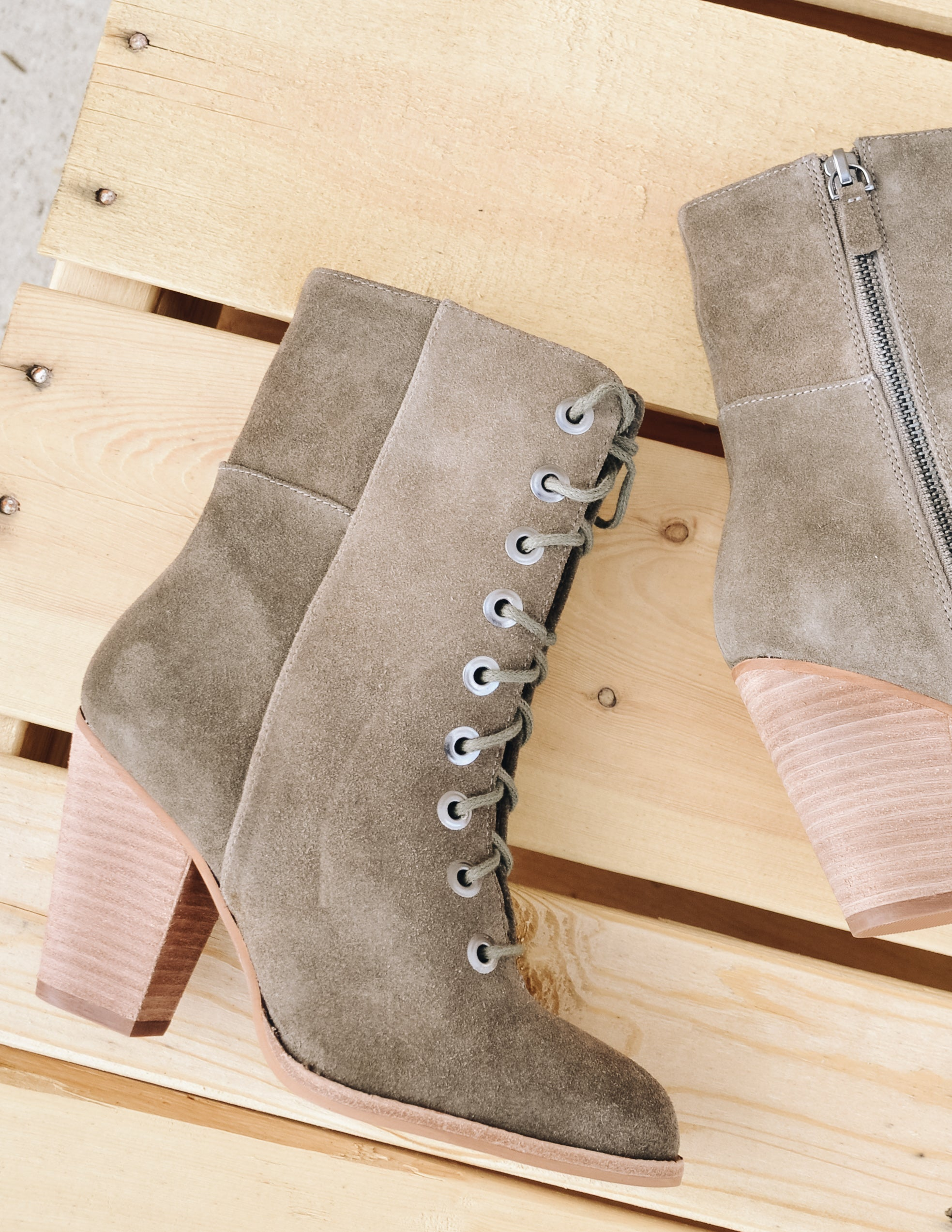 Taupe fontana boot heel laying flat on pallet wood - Elle Bleu