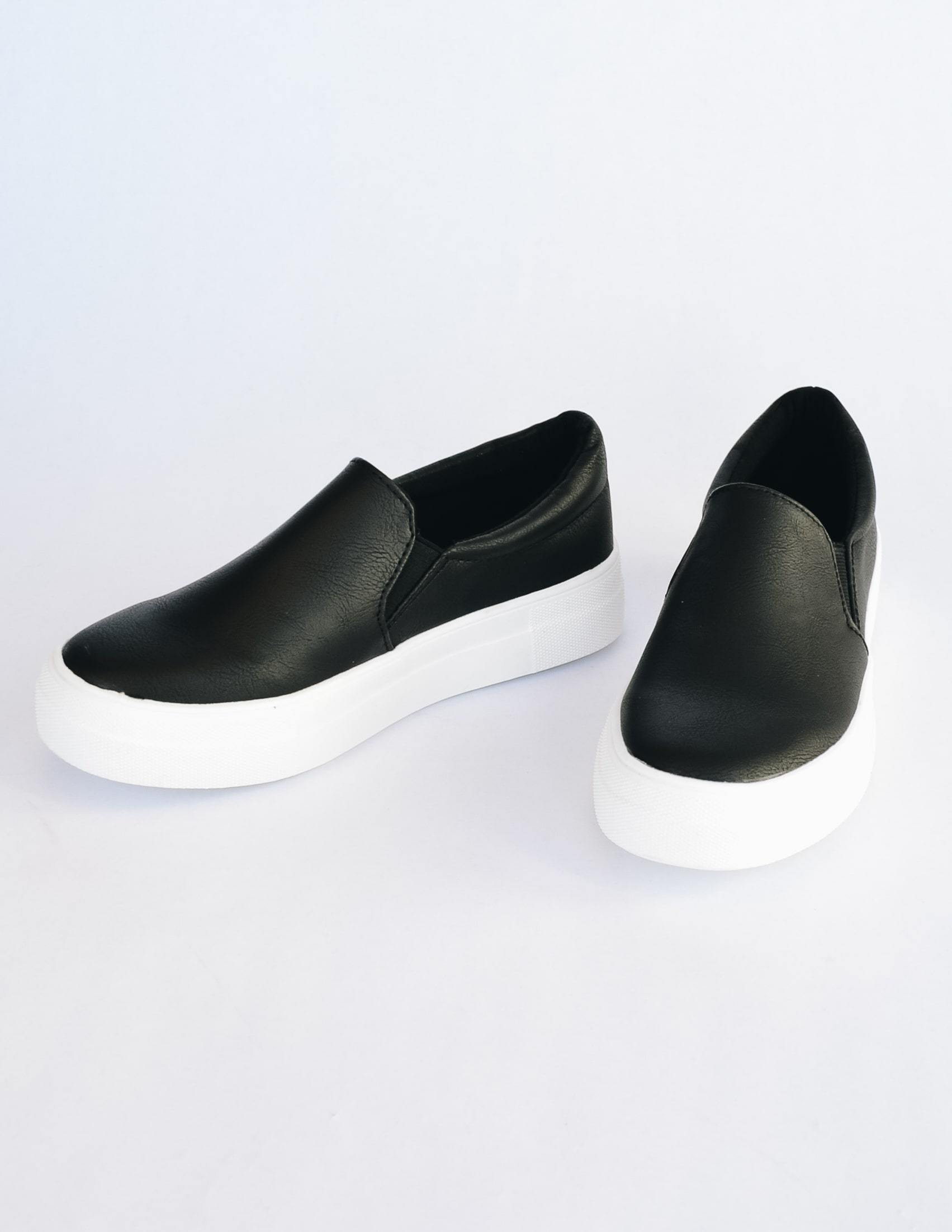 Black vegan leather slip on sneaker with white vulcanized rubber sole