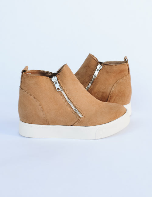 Tan Taylor sneaker with side zippers and round toe on white background