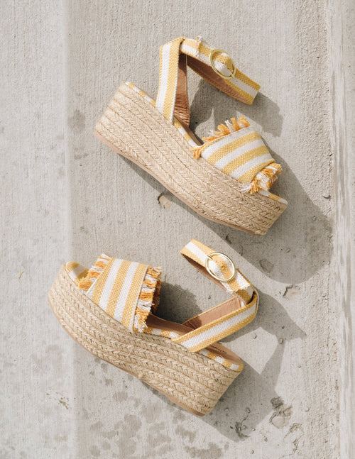 Cream and yellow striped canvas straps on espadrille esparto rope wrapped platform