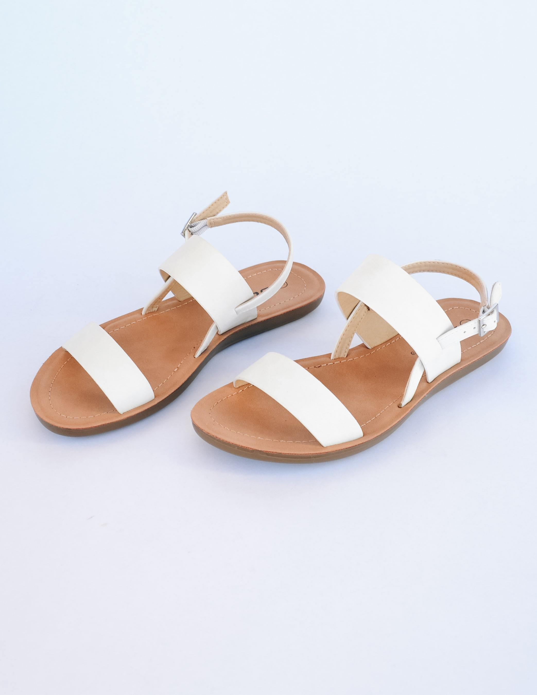 White strappy sandal with tan insole on white background - elle bleu